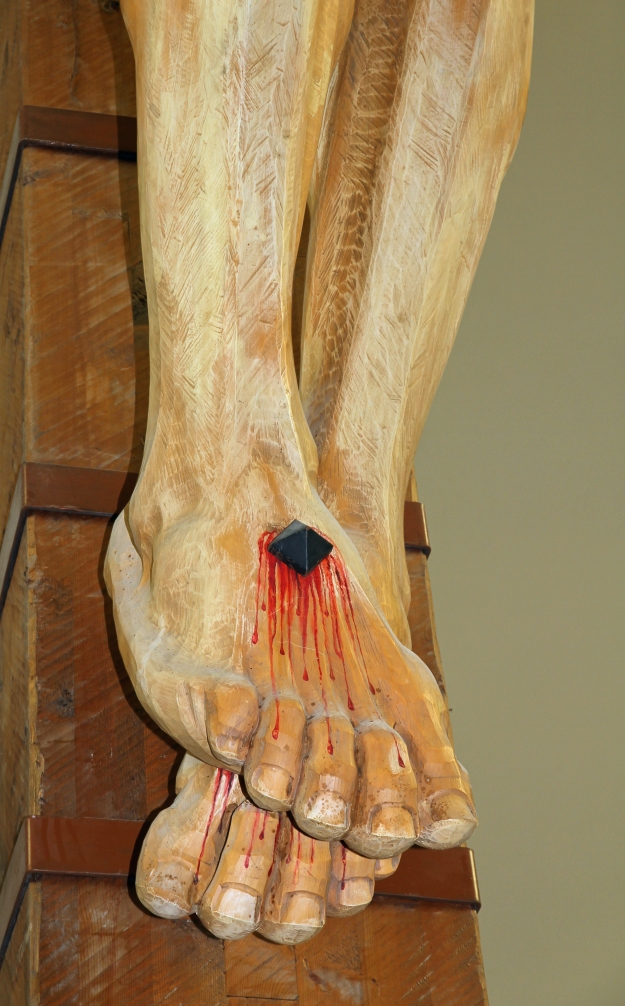 feet of Jesus Christ nailed to the cross